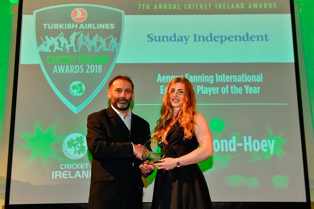 Una Raymond-Hoey is presented with her Aengus Fanning Emerging Player award by Sunday Independent sports editor John Greene. Photo: Sportsfile