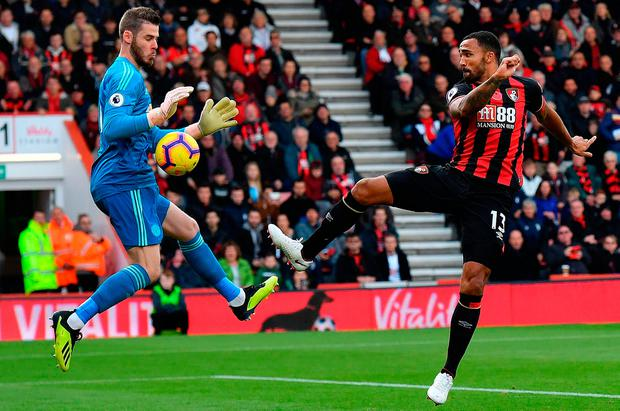 Manchester United's Spanish goalkeeper David de Gea (L) saves an attempt from Bournemouth's English striker Callum Wilson. Photo: Getty