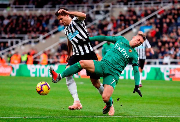 Federico Fernandez of Newcastle United is challenged by Gerard Deulofeu of Watford. Photo: Ian MacNicol/Getty Images