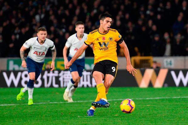 Raul Jimenez of Wolverhampton Wanderers scores his team's second goal. Photo: Ross Kinnaird/Getty Images
