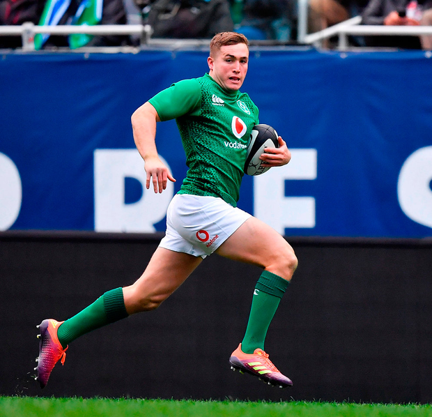 Ireland's hat-trick hero Jordan Larmour runs in his second try, and Ireland's fourth, during last night's comprehensive victory over Italy in Chicago. Photo: Brendan Moran