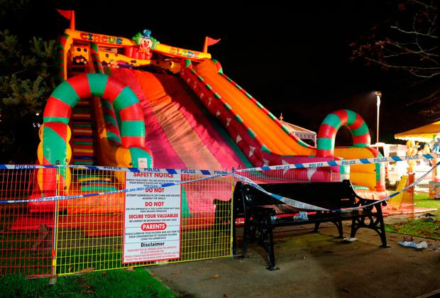 A view of the scene at a fireworks funfair in Woking Park, Surrey Credit: Andrew Matthews/PA Wire