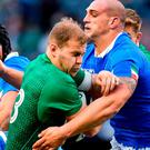 Will Addison is tackled by Federico Ruzza of Italy during the International Rugby match between Ireland and Italy at Soldier Field in Chicago, USA. Photo by Brendan Moran/Sportsfile