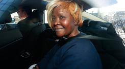 Grace Miano, 50, from Kenya pictured in the back of a garda car at the CCJ Credit: Damien Eagers / INM