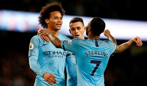 Manchester City's Leroy Sane celebrates scoring their sixth goal with Raheem Sterling and Phil Foden. REUTERS/Andrew Yates