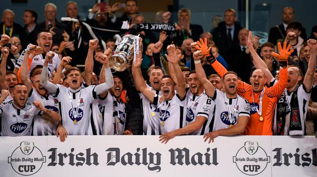 Dundalk captain Brian Gartland lifts the Irish Daily Mail FAI Senior Challenge Cup following the Irish Daily Mail FAI Cup Final match between Cork City and Dundalk at the Aviva Stadium in Dublin. Photo by Ramsey Cardy/Sportsfile