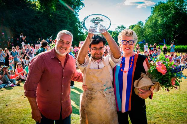 Rahul Mandal (centre) is crowned champion by judges Paul Hollywood and Prue Leith on 'Great British Bake Off'