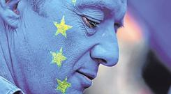 Facing facts: A man wears face paint in a European Union (EU) flag design ahead of the anti-Brexit People's Vote march, in London last month. Photo: Chris Ratcliffe/Bloomberg