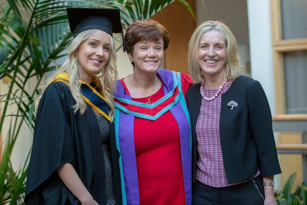 We've met before: Dr Kathleen Nallen (centre) was delighted to call Emily Campion (left) to the podium to collect her parchment when she graduated with her Bachelor in Science in Midwifery from DkIT, watched by Emily's mum Dolores (right). Photo: Ciara Wilkinson.