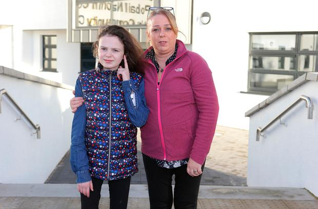Cecilia Semple and her daughter, Kelly, aged 13, pictured outside St Conleth's Community College in Newbridge, Co. Kildare. Photo: Damien Eagers/INM