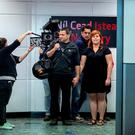 Starring role: Jim Warny and his partner Asia Mania during filming at Shannon Airport. Photo: Arthur Ellis