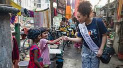 Helping hand: Rose of Tralee Kirsten Mate Maher visiting children in Chetla Lock Gate slum and railway community in Kolkata. Photo: Arthur Carron.