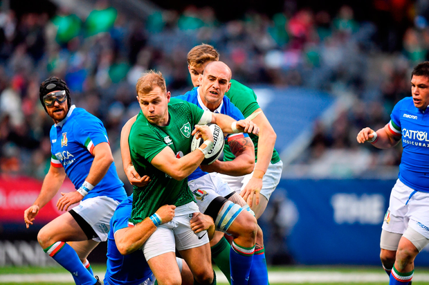 Will Addison of Ireland is tackled by Federico Ruzza of Italy. Photo by Brendan Moran/Sportsfile