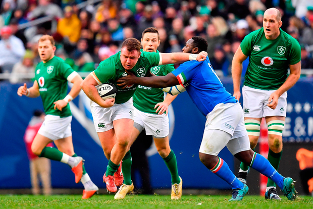 Dave Kilcoyne of Ireland is tackled by Cherif Traore' of Italy. Photo by Brendan Moran/Sportsfile
