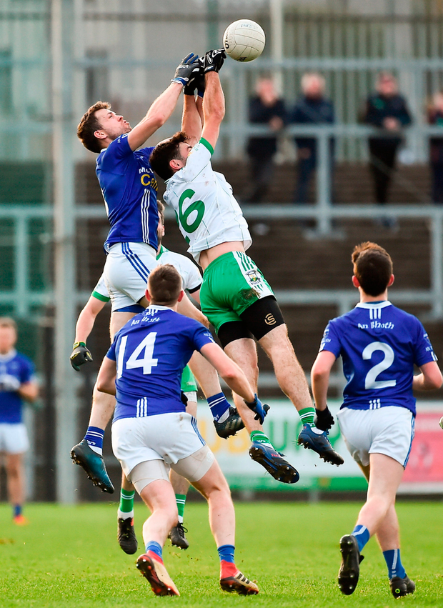 Burren No 6 Connor Toner in an aerial duel with Scotstown's Frank Caulfield (left) during yesterday's AIB Ulster club SFC clash at Newry. Photo by Oliver McVeigh/Sportsfile
