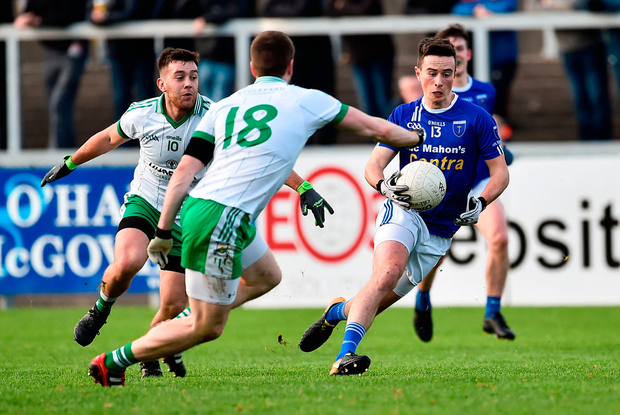 Shane Carey of Scotstown in action against Cathal Foy of Burren. Photo by Oliver McVeigh/Sportsfile