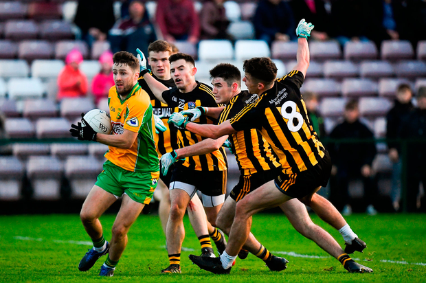 Micheál Lundy of Corofin in action against, from left, Michael Daly, Barry McHugh, Gary Sweeney and John Daly of Mountbellew-Moylough. Photo by Harry Murphy/Sportsfile