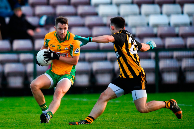 Micheál Lundy of Corofin in action against Gary Sweeney of Mountbellew-Moylough. Photo by Harry Murphy/Sportsfile