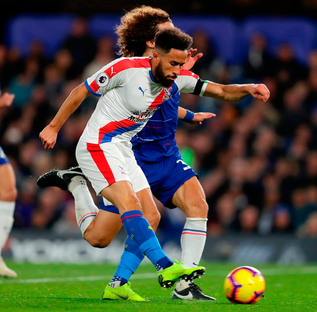Andros Townsend of Crystal Palace scores under pressure from David Luiz. Photo: Richard Heathcote/Getty Images
