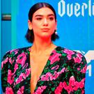 English singer Dua Lipa poses on the red carpet ahead of the MTV Europe Music Awards at the Bizkaia Arena in the northern Spanish city of Bilbao on November 4, 2018. (Photo by ANDER GILLENEA / AFP)