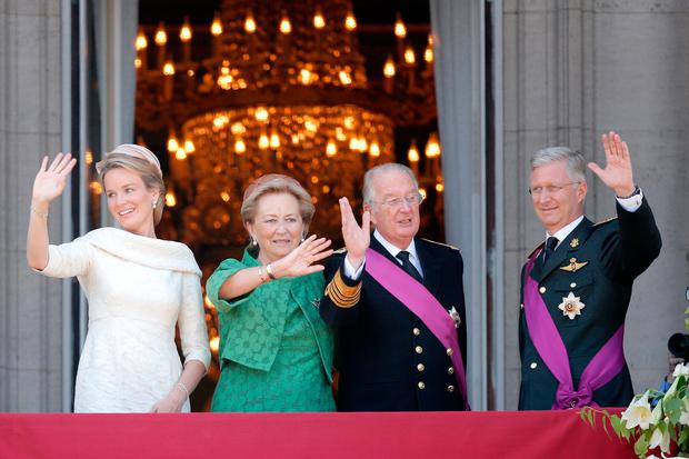 Queen Mathilde of Belgium, Princess Paola of Belgium, King Albert II of Belgium and King Philippe of Belgium are seen greeting the audience from the balcony of the Royal Palace during the Abdication Of King Albert II Of Belgium, & Inauguration Of King Philippe on July 21, 2013 in Brussels, Belgium. (Photo by Dean Mouhtaropoulos/Getty Images)