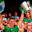Family affair: Tom (left) and Dan Morrissey lift the Liam MacCarthy Cup following Limerick's victory over Galway. Photo: Seb Daly/Sportsfile