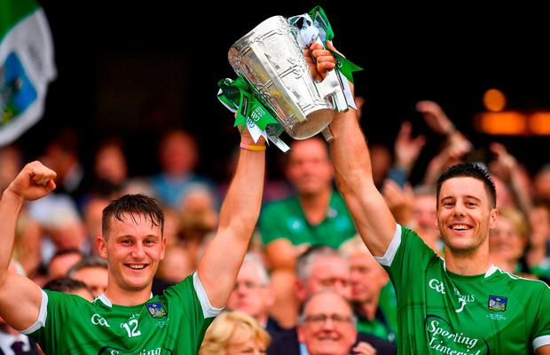 Tom (left) and Dan Morrissey lift the Liam MacCarthy Cup