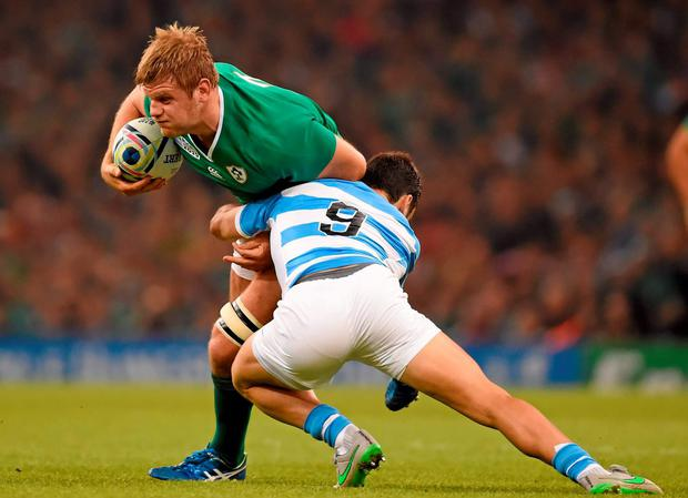 Chris Henry is tackled by Martin Landajo of Argentina during the 2015 Rugby World Cup Quarter-Final. Photo: Sportsfile