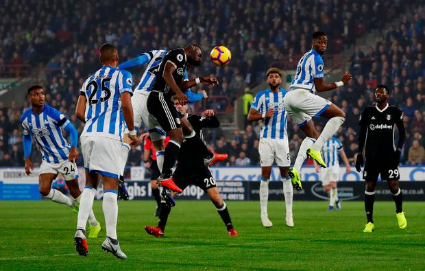 Fulham's Timothy Fosu-Mensah heads the ball into his own net to give Huddersfield their first league victory of the season. Photo: Action Images via Reuters