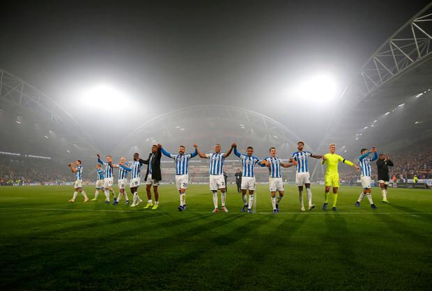 Huddersfield players salute their fans as they celebrate their first Premier League victory of the season. Photo: Action Images via Reuters