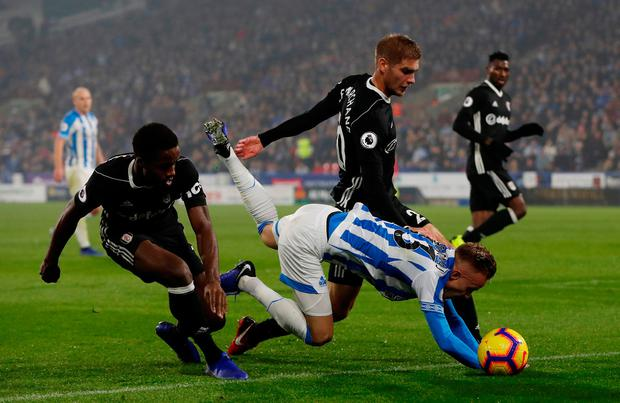Huddersfield Town's Florent Hadergjonaj is pressured off the ball by Fulham's Maxime Le Marchand and Ryan Sessegnon. Photo: Action Images via Reuters