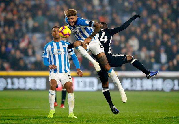 Philip Billing and Fulham's Jean Michael Seri battle for the ball. Photo: PA