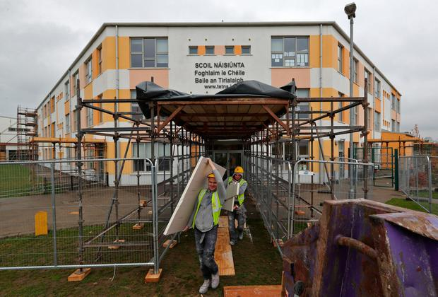 Closed for repairs: Builders carry out remedial work at St Luke's National School, Tyrrelstown, Dublin. The school closed to pupils last week due to safety concerns. Photo: Colin Keegan, Collins Dublin.