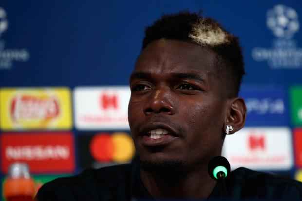 Manchester United's French midfielder Paul Pogba speaks during a press conference at the Juventus Allianz stadium in Turin on November 6, 2018 on the eve of the UEFA Champions League group H football match Juventus vs Manchester United . (Photo by Isabella BONOTTO / AFP)