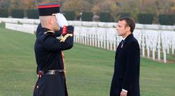 Salute: Emmanuel Macron attends a ceremony near Verdun, France, yesterday. Photo: Ludovic Marin/Pool via REUTERS