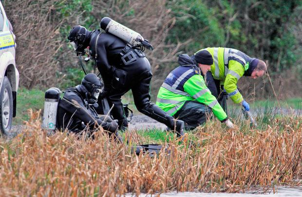 Probe: Garda underwater unit members search the Grand Canal in January 2016 as part of the investigation into Kenneth O'Brien's murder. Photo: Colin Keegan, Collins
