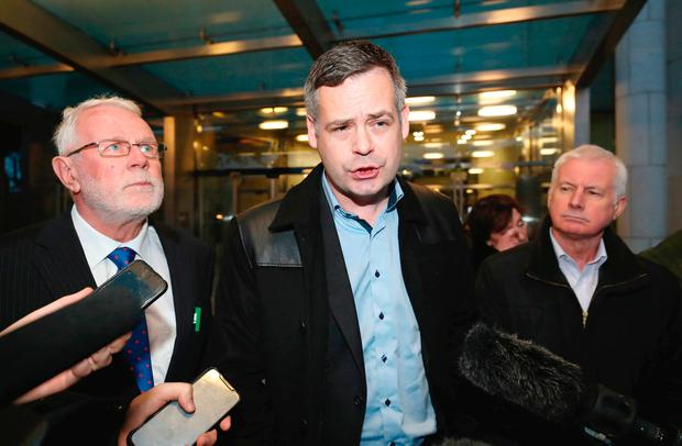 Support: Sinn Féin TDs (l-r) Martin Ferris, Pearse Doherty and Sean Crowe outside the High court in Dublin where John Downey appeared. Photo: PA