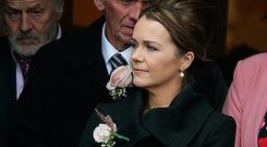 Eileen Loughlin holds a picture of her daughter Annabel at the funeral. Photos: Damien Eagers