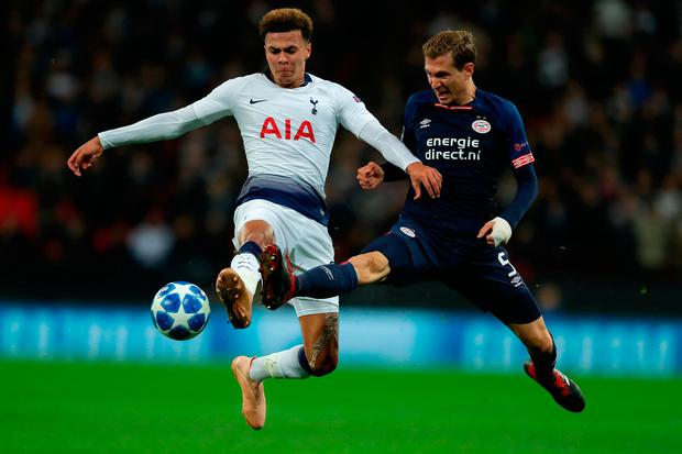 Dele Alli of Tottenham is challenged by Daniel Schwaab of PSV. Photo: Richard Heathcote/Getty Images