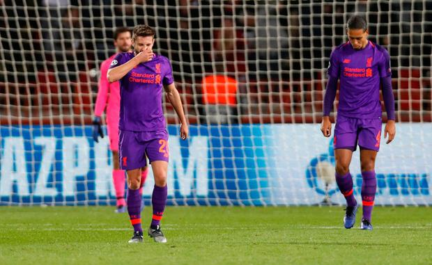 Liverpool's Adam Lallana and Virgil van Dijk look dejected after Crvena Zvezda's first goal