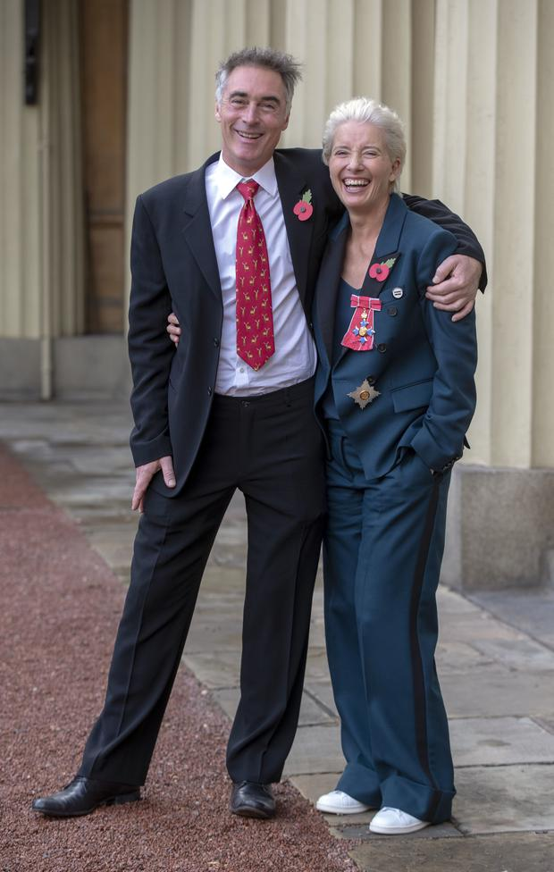 With husband Greg Wise outside Buckingham Palace (Steve Parsons/PA)