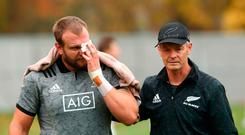 LONDON, ENGLAND - NOVEMBER 06: Joe Moody is assisted by Dr Tony Page after suffering a bad cut to his eye during a New Zealand All Blacks training session at the Lensbury Hotel on November 6, 2018 in London, England. (Photo by Phil Walter/Getty Images)