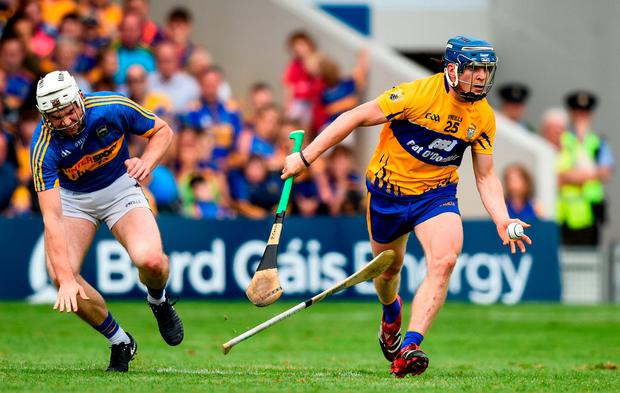 Podge Collins in action against Brendan Maher during the Munster SHC match at Semple Stadium in June. Photo: David Fitzgerald/Sportsfile