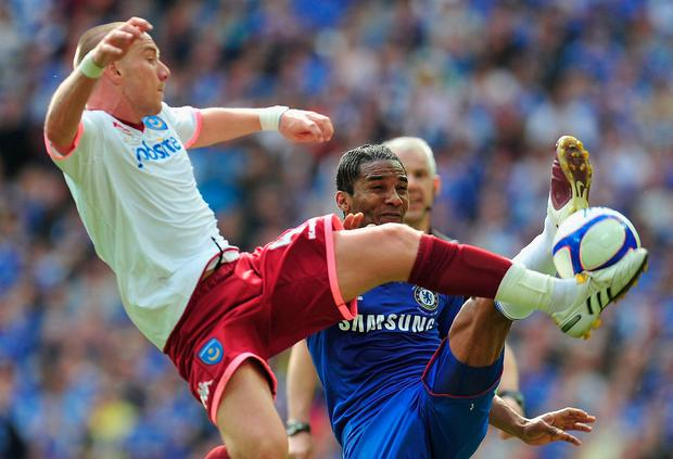 Jamie O'Hara tackling Florent Malouda in the 2010 FA Cup final with Portsmouth. Photo: Clive Mason/Getty Images