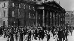 Destroyed: Crowds gather at the GPO after the Easter Rising. Photo: Mansell/Time & Life Pictures/Getty Images