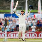 England's Ben Foakes (L) celebrates his century next to his teammate James Anderson. Photo: REUTERS/Dinuka Liyanawatte