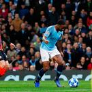 Raheem Sterling catches his toe in the turf and is awarded a penalty during Manchester City's victory last night. Photo: Reuters