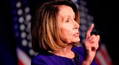 Taking stand: House Minority Leader Nancy Pelosi speaks during a midterm election night party. Picture: AFP