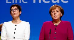 Annegret Kramp-Karrenbauer and Angela Merkel. Photo: Reuters