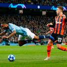 Manchester City's Raheem Sterling goes down and is later awarded a penalty